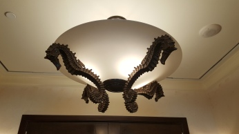 Seahorse chandelier at the entrance... love this.